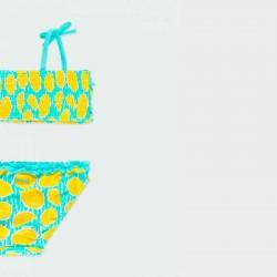 bikini de niña amarillo y turquesa por detrás