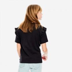 niña con camiseta garcia jeans gris acero por detrás