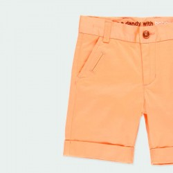detalle bermuda naranja niño de vestir