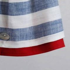 detalle bajos vestido niña de vestir rayas azules y rojo