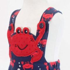 detalle peto bebe rojo y marino de cangrejos bas marti