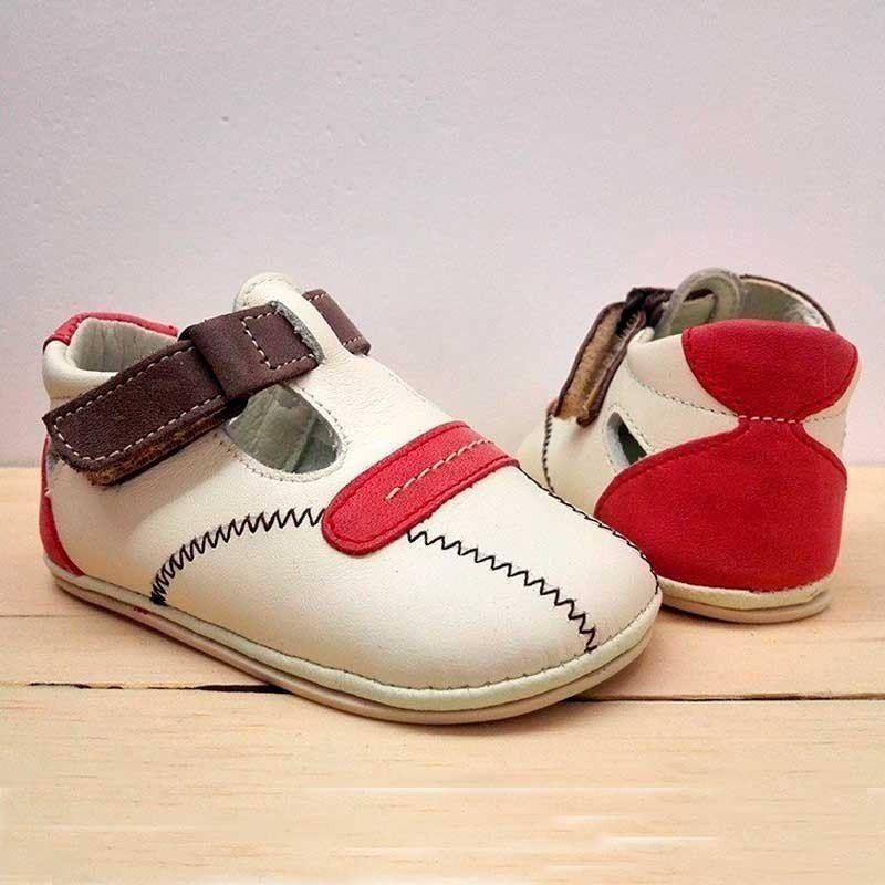 zapatos bebe de piel beig y rojos