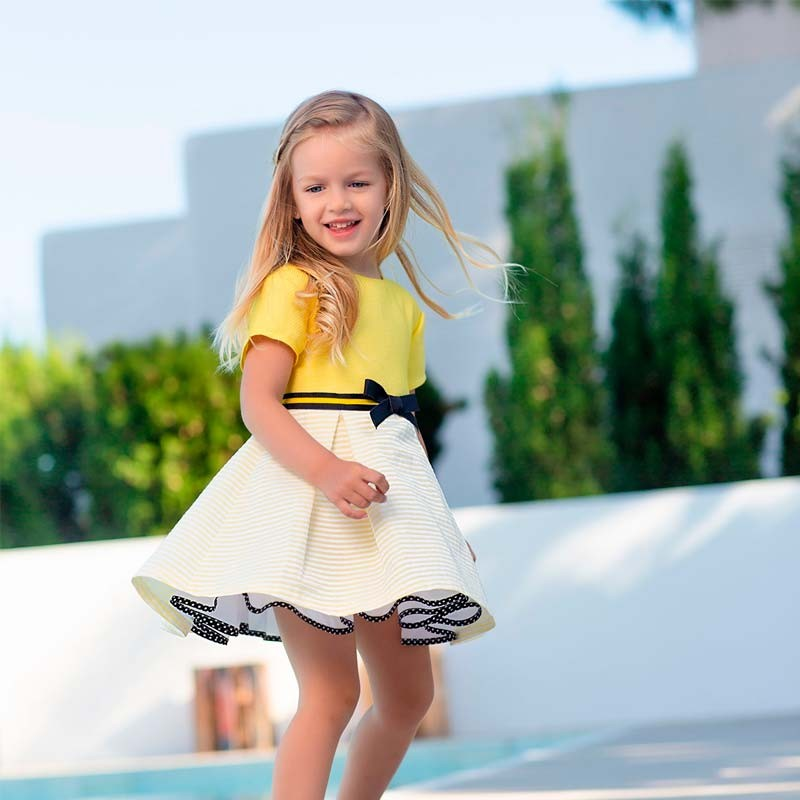 vestido niña amarillo con lazo negro